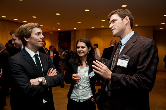 Members of the Cornell Real Estate Club at a social gathering